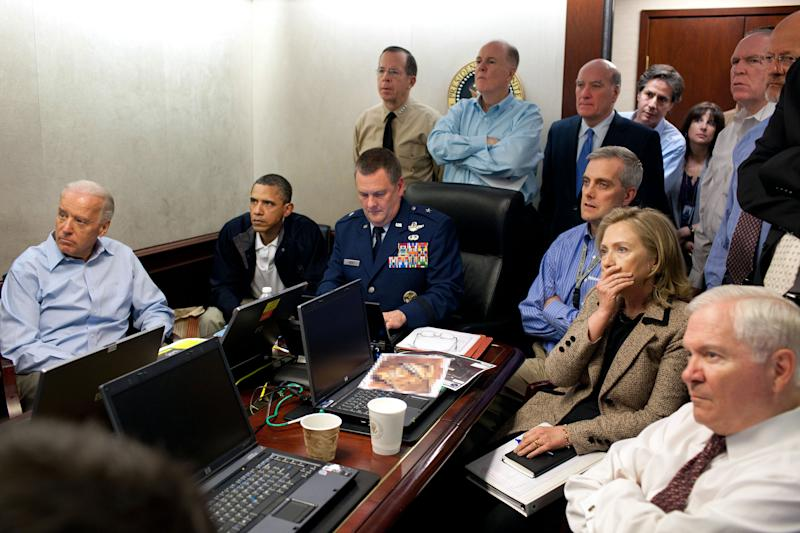 In this image released by the White House and digitally altered by the source to diffuse the paper in front of Secretary of State Hillary Rodham Clinton, President Barack Obama and Vice President Joe Biden, along with with members of the national security team, receive an update on the mission against Osama bin Laden in the Situation Room of the White House, Sunday, May 1, 2011, in Washington. (AP Photo/The White House, Pete Souza)