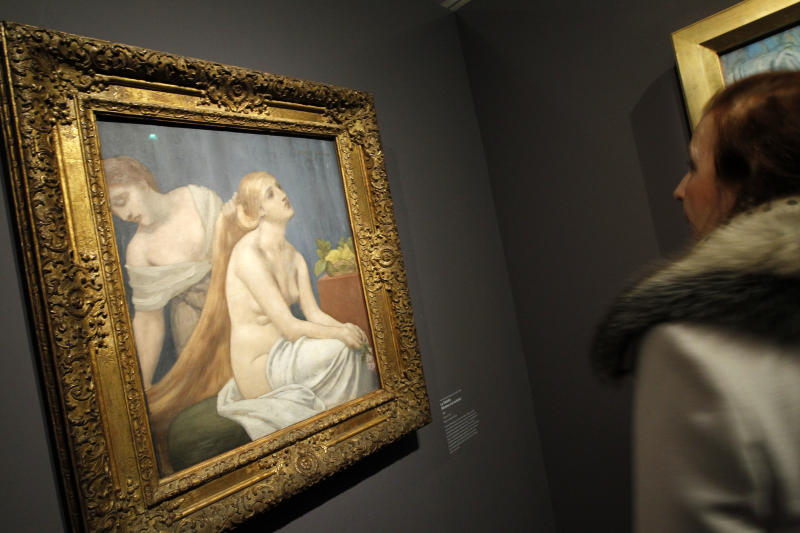 """A woman watches """"La toilette"""", a painting by Pierre Puvis de Chavannes as part of the exhibition """" Degas and the Nude"""" in Paris, Monday, March 12, 2012. This exhibition has been organised by the Musee d' Orsay and the Museum of Fine Arts, Boston, and takes place from March 13 to July 1, 2012. (AP Photo/Christophe Ena)"""