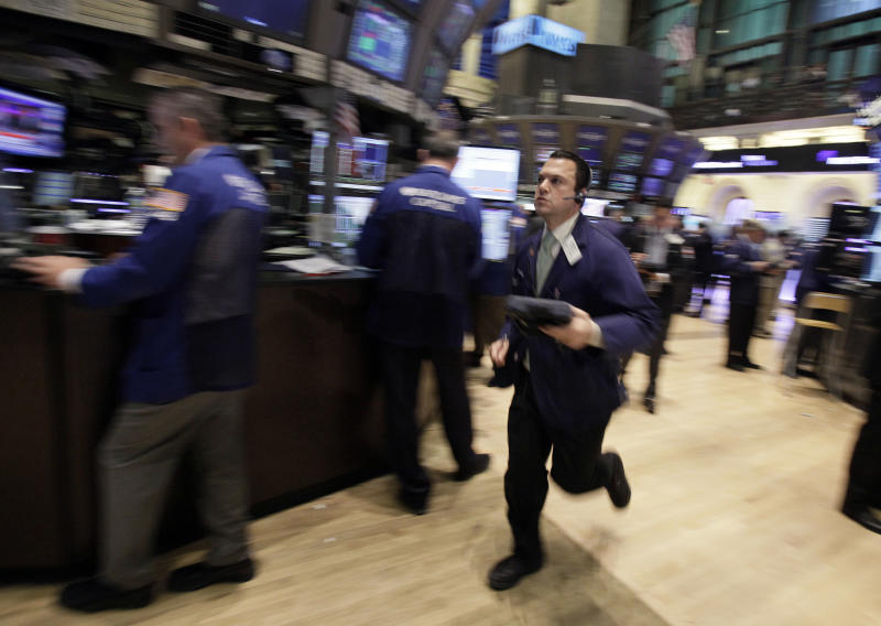 Trader Michael Zicchinolfi runs across  the floor the New York Stock Exchange Wednesday, Nov. 9, 2011. The Dow Jones industrial average lost more than 240 points in early trading after Italy's borrowing costs soared.(AP Photo/Richard Drew)