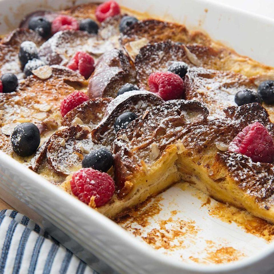 """<p>This french toast is perfect for feeding a crowd. It's not too sweet, not too heavy, and amazing with icing sugar or maple syrup. (Or both, we won't judge.) </p><p>Get the <a href=""""https://www.delish.com/uk/cooking/recipes/a31658787/easy-french-toast-casserole-recipe/"""" rel=""""nofollow noopener"""" target=""""_blank"""" data-ylk=""""slk:French Toast Casserole"""" class=""""link rapid-noclick-resp"""">French Toast Casserole</a> recipe.</p>"""