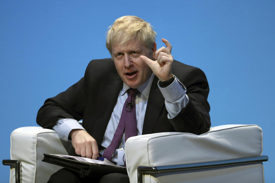 Britain's Conservative party leadership candidate Boris Johnson gestures during the first party hustings at the ICC in Birmingham, England, Saturday June 22, 2019. The two finalists in the race to lead Britain's governing Conservative Party and become the country's new prime minister made their first formal pitches to party members Saturday.  (AP Photo/Rui Vieira)