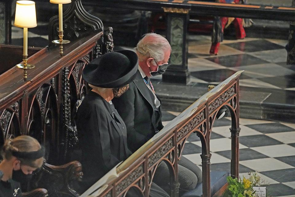 WINDSOR, ENGLAND - APRIL 17: Prince Charles, Prince of Wales and Camilla, Duchess of Cornwall attend the funeral of Prince Philip, Duke of Edinburgh, at St George's Chapel at Windsor Castle on April 17, 2021 in Windsor, England. Prince Philip of Greece and Denmark was born 10 June 1921, in Greece. He served in the British Royal Navy and fought in WWII. He married the then Princess Elizabeth on 20 November 1947 and was created Duke of Edinburgh, Earl of Merioneth, and Baron Greenwich by King VI. He served as Prince Consort to Queen Elizabeth II until his death on April 9 2021, months short of his 100th birthday. His funeral takes place today at Windsor Castle with only 30 guests invited due to Coronavirus pandemic restrictions. (Photo by Yui Mok - WPA Pool/Getty Images)