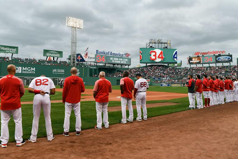 June 10, 2019: The Red Sox stand for a moment of silence for former team member David Ortiz before a game against the Rangers at Fenway Park.