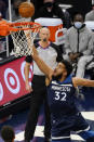Minnesota Timberwolves' Karl-Anthony Towns (32) lays up a shot in the first half of an NBA basketball game against the Memphis Grizzlies, Wednesday, Jan. 13, 2021, in Minneapolis. (AP Photo/Jim Mone)