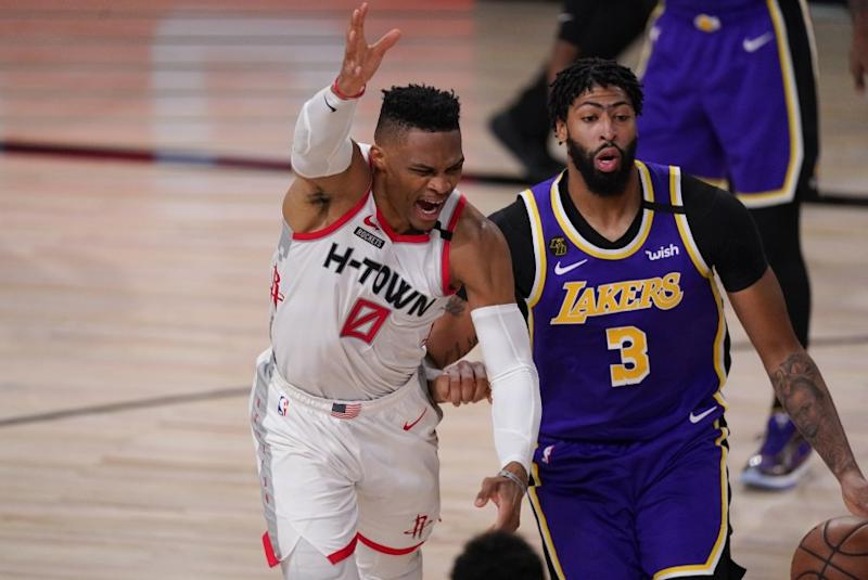 The Rockets' Russell Westbrook, left, loses the ball while being defended by the Lakers' Anthony Davis on Sept. 4, 2020.