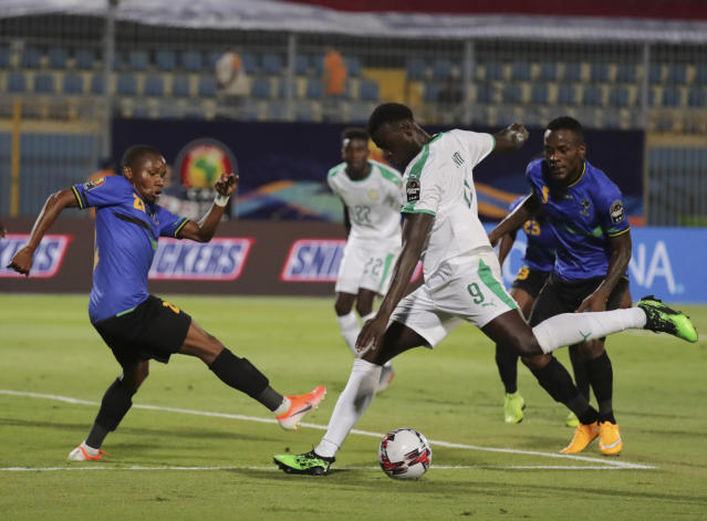 Tanzania's Mudathir Yahya Abbas, left, tries to block Senegal's Idrissa Gana Gueye during the African Cup of Nations group C soccer match between Senegal and Tanzania at 30 June Stadium in Cairo, Egypt, Sunday, June 23, 2019. (AP Photo/Hassan Ammar)