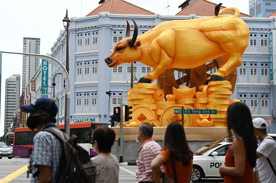 Pedestrians seen near a Chinese New Year decoration marking the Year of the Ox in Singapore's Chinatown district on. (PHOTO: Getty Images)