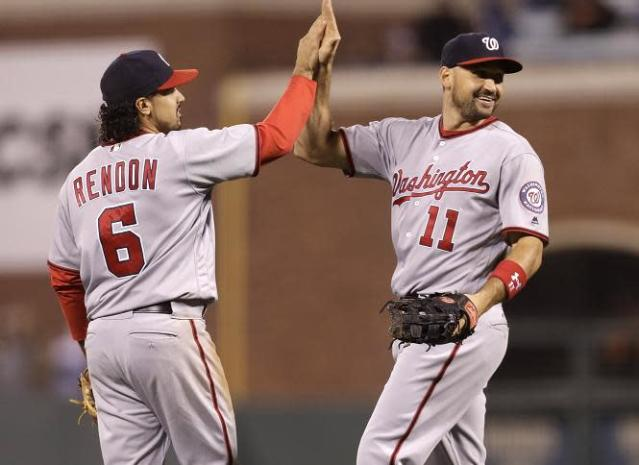 "Anthony Rendon (left) and <a class=""link rapid-noclick-resp"" href=""/mlb/players/7627/"" data-ylk=""slk:Ryan Zimmerman"">Ryan Zimmerman</a> (right) combined for a historic triple play. (AP)"