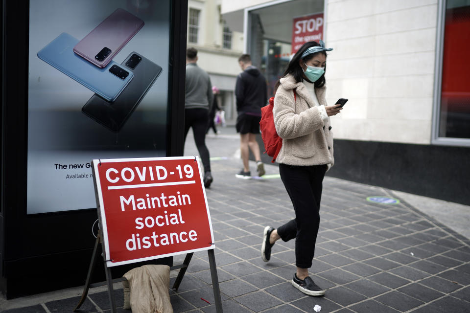 LIVERPOOL, UNITED KINGDOM - JULY 14: People wear face masks as they go shopping on July 14, 2020 in Liverpool, United Kingdom. The UK government has announced that people entering shops will be required to wear a face mask by law from July 24. Scientists have also predicted a 'worse case scenario' of a second wave of Covid-19 related deaths between 24,500 and 251,000 in hospitals alone in a report requested by the UK's chief scientific adviser, Sir Patrick Vallance. (Photo by Christopher Furlong/Getty Images)
