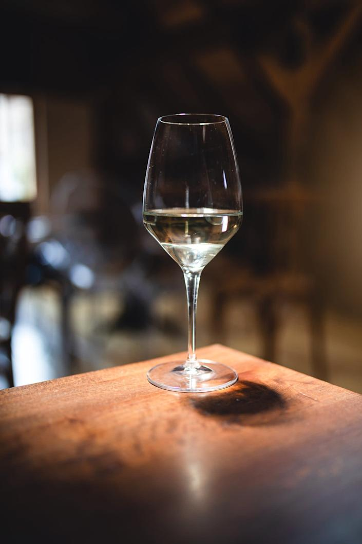 Many online wine retailers have discount codes, free delivery and offer on to take advantage of (Getty)Getty Images