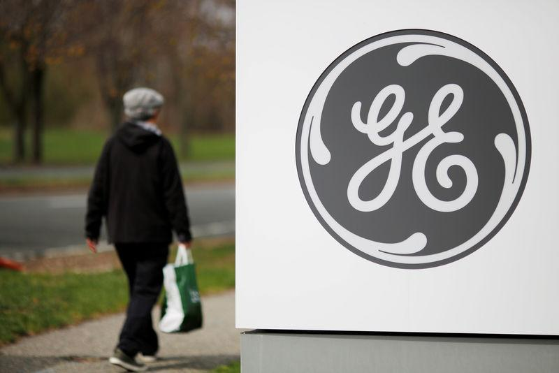 FILE PHOTO: A pedestrian walks past a General Electric facility in Medford