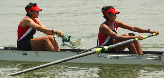 Joanna Chan Lai Cheng and Saiyidah Aisyah of Singapore warm up for the women's pairs on day four of the 2011 Southeast Asian Games at Danau Cipule Regatta Course on November 14, 2011 in Jakarta, Indonesia. (Photo by Cameron Spencer/Getty Images)