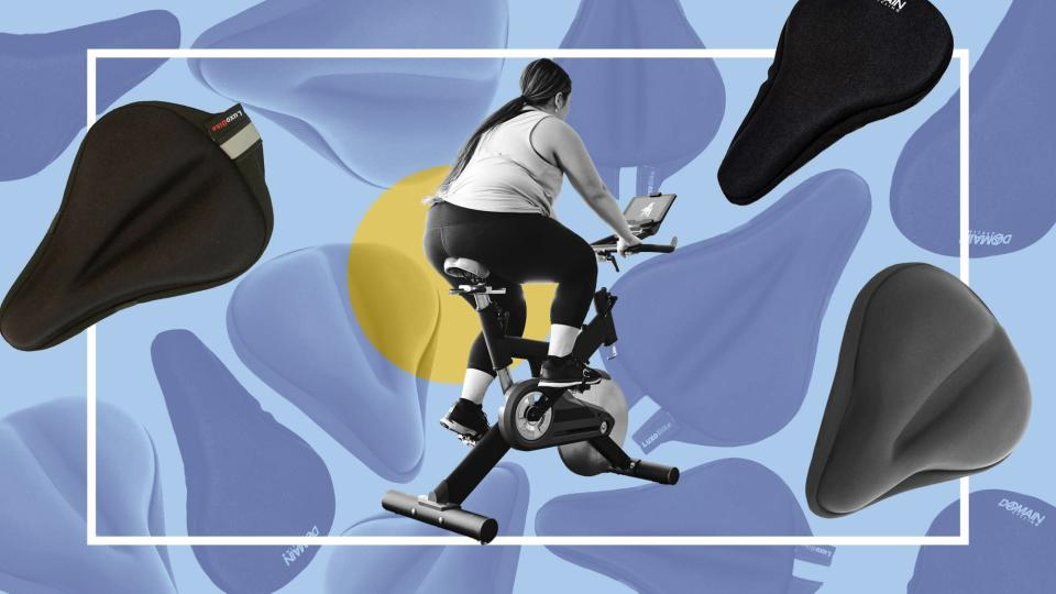 These Peloton Seat Cushions Make Any Bike More Comfortable , A woman exercising in her home on an exercise bike.