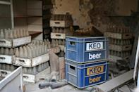 Abandoned crates of the local Cypriot beer remain at a dilapidated storage space in the fenced-off area of Varosha