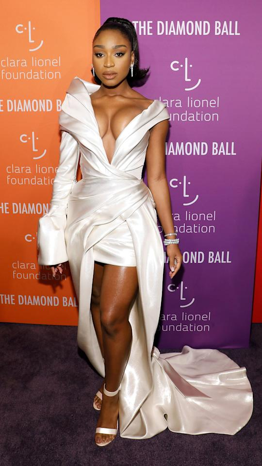 We're still not over Normani's all-silver ensemble for Rihanna's Diamond Ball. This look has <em>a lot</em> to take in, but we're particularly fond of her dress sleeves. As this photo shows, one sleeve was long and bell-shaped, and the other was nonexistent, which made for a very artistic look. Plus, the silver shoes, drop earrings, and bracelet added a touch of silver elegance.