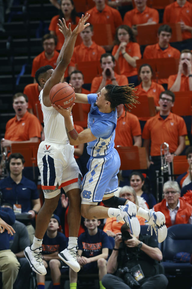 North Carolina guard Cole Anthony (2) takes a shot as Virginia guard Casey Morsell (13) defends during the second half of an NCAA college basketball game in Charlottesville, Va., Sunday, Dec. 8, 2019. Virginia defeated North Carolina 56-47. (AP Photo/Steve Helber)