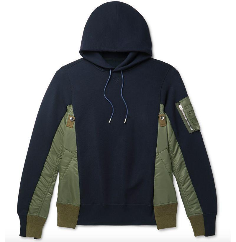 """<p><strong>Sacai</strong></p><p>mrporter.com</p><p><strong>$650.00</strong></p><p><a href=""""https://go.redirectingat.com?id=74968X1596630&url=https%3A%2F%2Fwww.mrporter.com%2Fen-us%2Fmens%2Fproduct%2Fsacai%2Fclothing%2Fhoodies%2Fsponge-sweat-x-ma-1-shell-panelled-cotton-blend-jersey-hoodie%2F29012654081572971&sref=https%3A%2F%2Fwww.esquire.com%2Fstyle%2Fmens-fashion%2Fg3357%2Fbest-hoodies-men%2F"""" rel=""""nofollow noopener"""" target=""""_blank"""" data-ylk=""""slk:Buy"""" class=""""link rapid-noclick-resp"""">Buy</a></p><p><em>Oooh</em>, baby. Sacai's sweatshirt combines elements of a classic MA-1 bomber jacket with a cotton jersey fabric in a mash-up that looks straight bomb.<br></p>"""