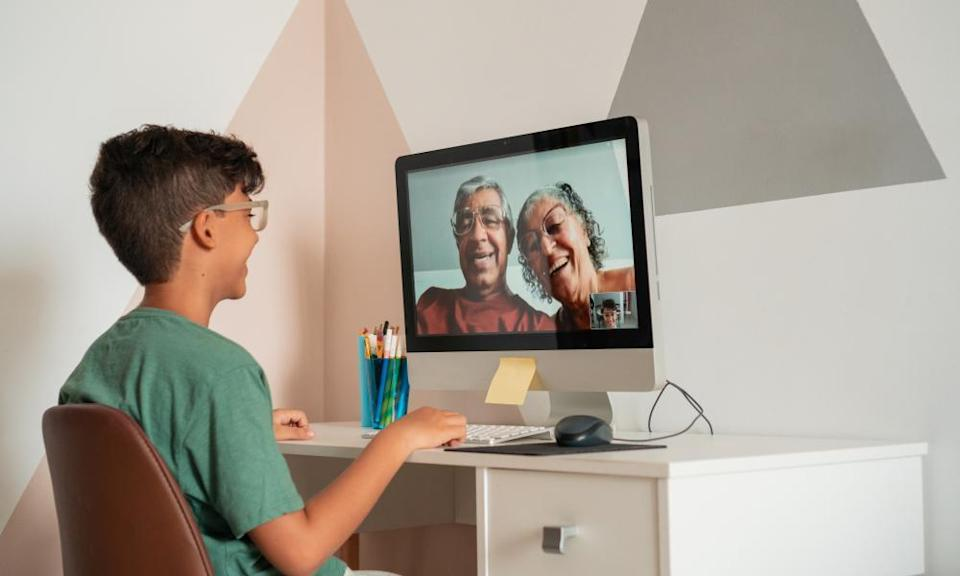 A boy talking to his grandparents over video chat.