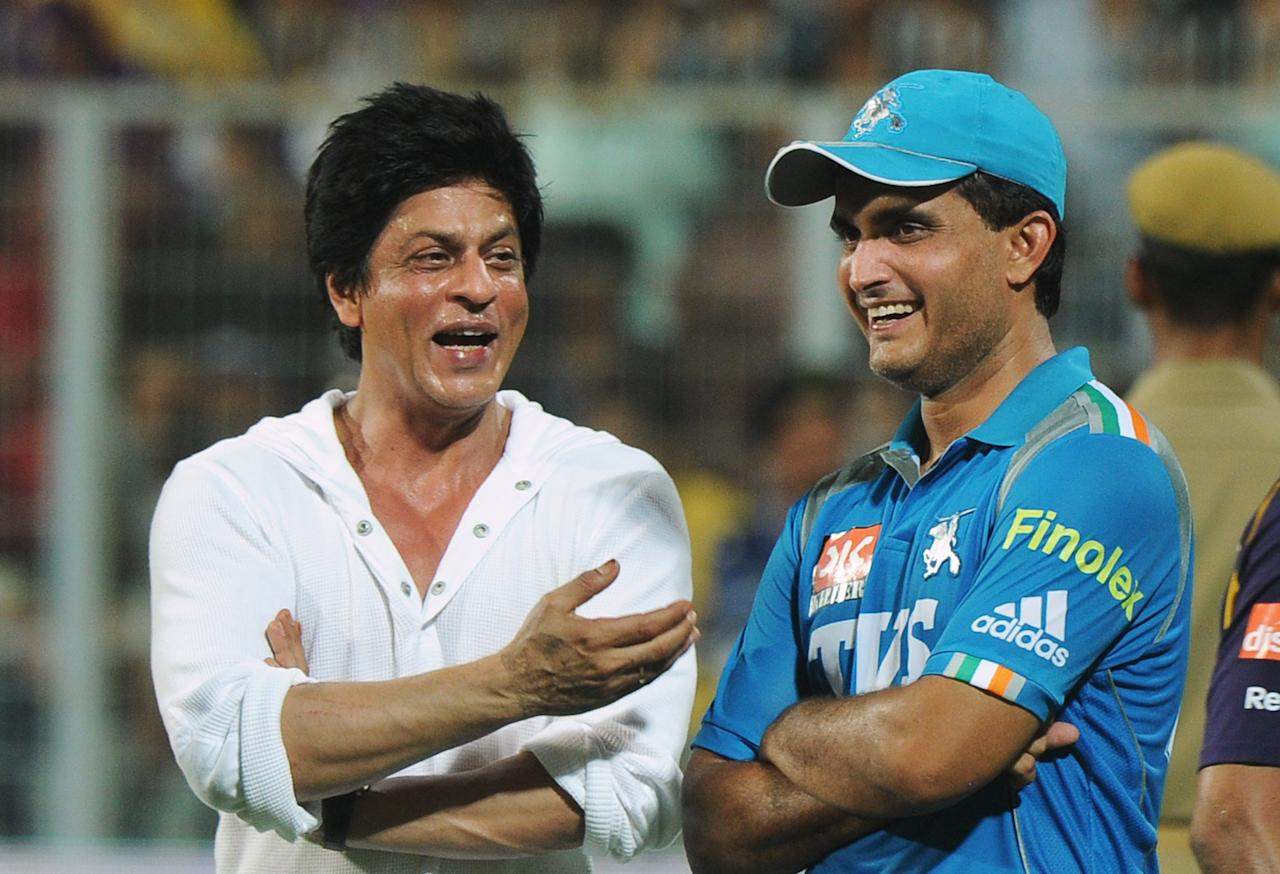 Pune Warriors India captain Sourav Ganguly (R) interacts with Bollywood actor and Kolkata Knight Riders co-owner Shah Rukh Khan after the IPL match between Kolkata and Pune at the Eden Gardens in Kolkata on May 5, 2012.(DIBYANGSHU SARKAR/AFP/GettyImages)