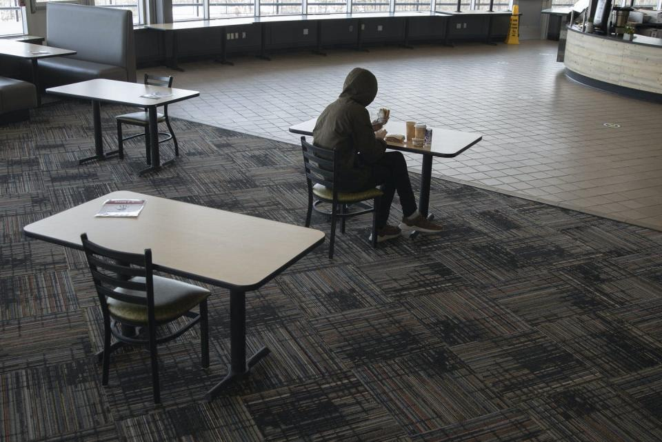 """<span class=""""caption"""">Stigma and lack of awareness prevent students from getting food assistance.</span> <span class=""""attribution""""><a class=""""link rapid-noclick-resp"""" href=""""https://www.gettyimages.com/detail/news-photo/student-eats-lunch-at-brooks-dining-hall-on-the-university-news-photo/1231259787?adppopup=true"""" rel=""""nofollow noopener"""" target=""""_blank"""" data-ylk=""""slk:Derek Davis/Portland Press Herald via Getty Images"""">Derek Davis/Portland Press Herald via Getty Images</a></span>"""