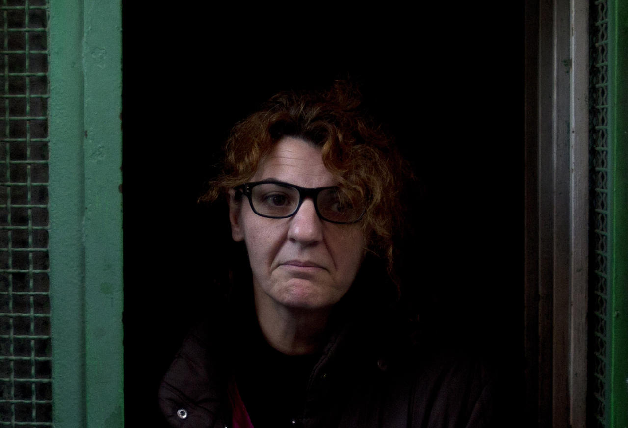 45-year old office manager Irene Gonzalez of Spain stands by her front door while she waits to be evicted from her home, in Madrid Monday Nov. 19, 2012. The police and court officials did not show up at the planned time and she still does not know if they will come later or on another day to evict her. Spain approved a two-year suspension of evictions Thursday for some needy homeowners unable to pay their mortgages, but activists said the government failed to address the larger issue of how those who give up their homes may still remain indebted, sometimes for the rest of their lives. Public attention on the issue intensified greatly in recent weeks after two homeowners facing eviction committed suicide. (AP Photo/Paul White)