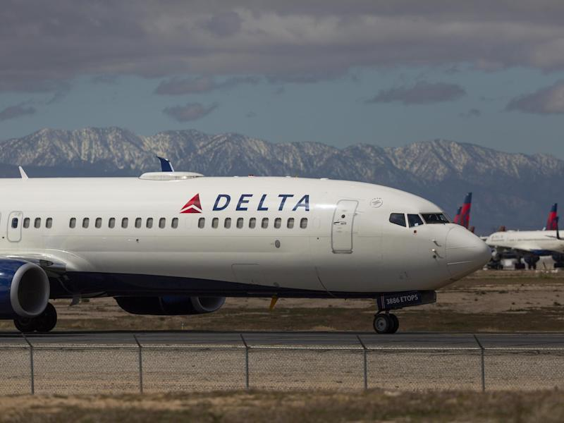 A Delta Air Lines jet taxis to be parked with a growing number of jets at Southern California Logistics Airport: (2020 Getty Images)