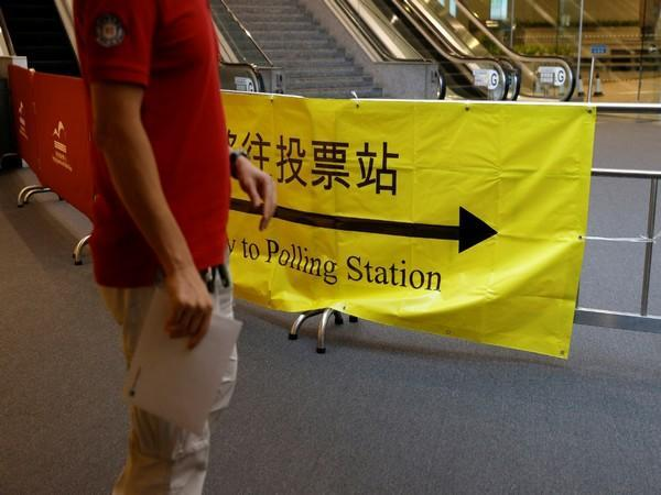 A voter walks into a polling station during the voting of the election committee in Hong Kong. (Photo credit: Reuters)