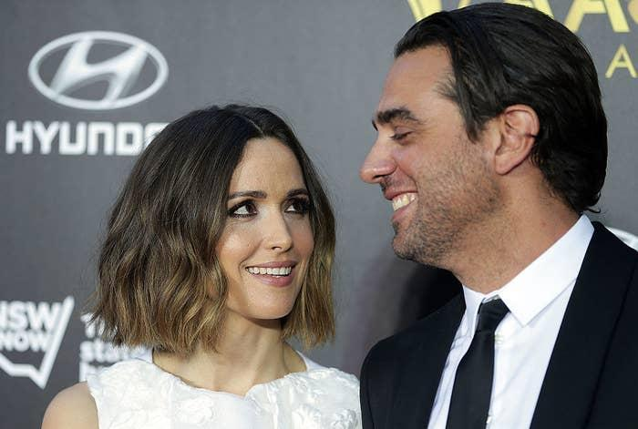 Rose Byrne (L) and Bobby Cannavale smile at each other on the 4th AACTA Awards Ceremony red carpet