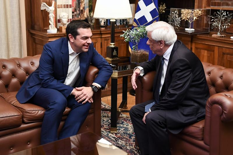 Greek Prime Minister Alexis Tsipras, seen speaking with President Prokopis Pavlopoulos, called early elections after losses at recent European and local elections (AFP Photo/Aris MESSINIS)
