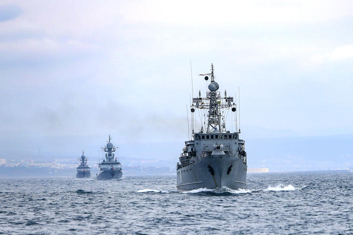 This handout photo released on Wednesday, April 14, 2021 by Russian Defense Ministry Press Service shows, Russian navy ships are seen during navy drills in the Black Sea. Russia has insisted that it has the right to close areas of the Black Sea for foreign naval ships and rejected Ukrainian and Western criticism of the move. (Russian Defense Ministry Press Service via AP)