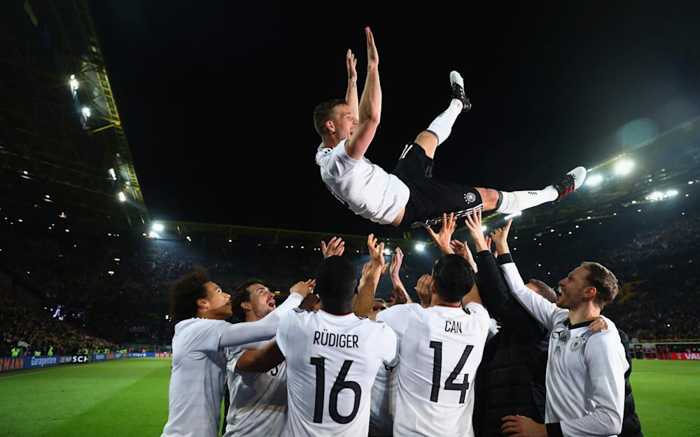 Podolski celebrates with team-mates