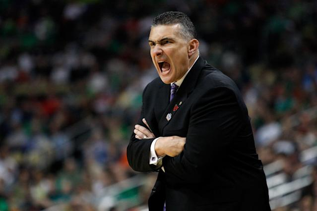 PITTSBURGH, PA - MARCH 17: Fead coach Frank Martin of the Kansas State Wildcats reacts as he coaches against the Syracuse Orange during the third round of the 2012 NCAA Men's Basketball Tournament at Consol Energy Center on March 17, 2012 in Pittsburgh, Pennsylvania. (Photo by Jared Wickerham/Getty Images)