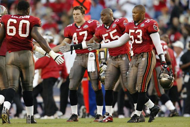 Shelton Quarles, right, is a former teammate of new 49ers GM John Lynch, second from left, and says he'll have a lot to learn on the job. (Getty Images)