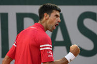 Serbia's Novak Djokovic celebrates a winning point as he plays Spain's Rafael Nadal during their semifinal match of the French Open tennis tournament at the Roland Garros stadium Friday, June 11, 2021 in Paris. (AP Photo/Michel Euler)