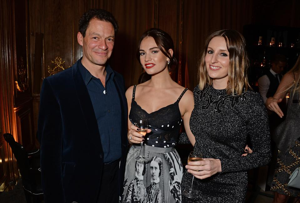 LONDON, ENGLAND - OCTOBER 30: (L to R) Dominic West, Lily James and Laura Carmichael attend the Harper's Bazaar Women Of The Year Awards 2018, in partnership with Michael Kors and Mercedes-Benz, at Claridge's Hotel on October 30, 2018 in London, England. (Photo by David M. Benett/Dave Benett/Getty Images for Harper's Bazaar/Hearst UK)