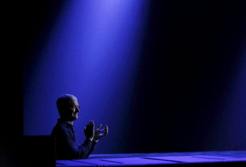 Apple CEO Tim Cook waits to return to stage during his keynote address at the Worldwide Developers Conference in San Francisco