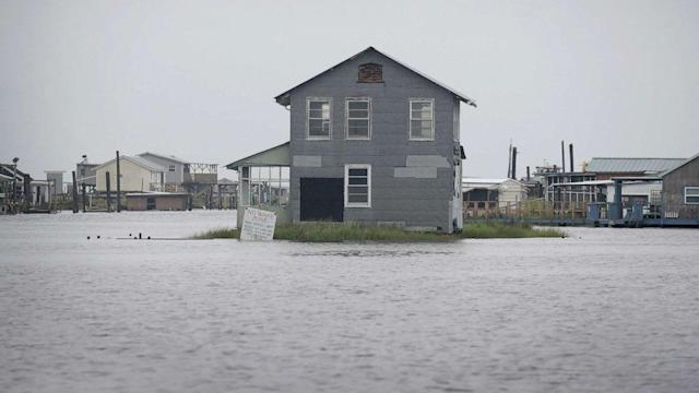 Flooded Louisiana cleans up from Barry but dodges 'worst-case scenario'; storm moves north dumping more rain (ABC News)