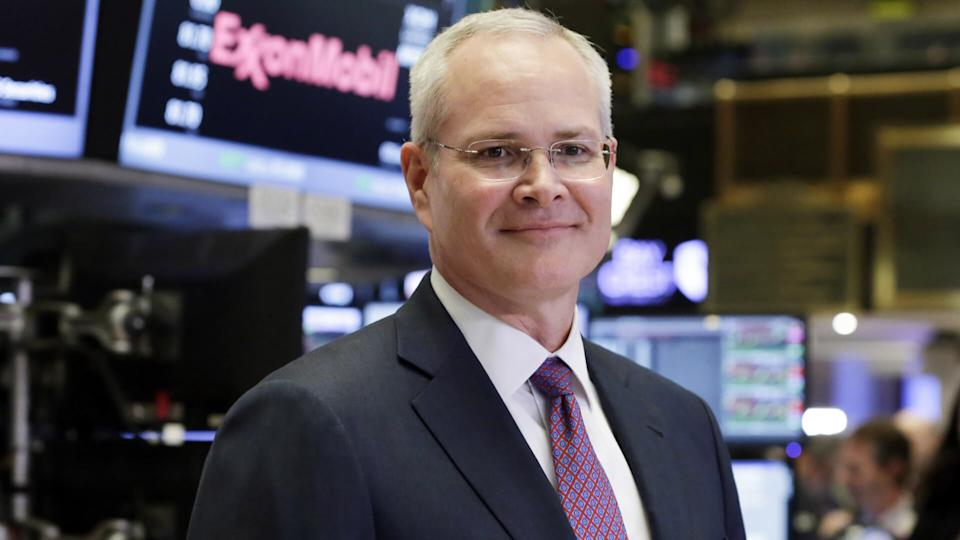 Mandatory Credit: Photo by Richard Drew/AP/REX/Shutterstock (8450730a)Exxon Mobil Corporation Chairman & CEO Darren Woods poses for a photo on the floor of the New York Stock Exchange, .