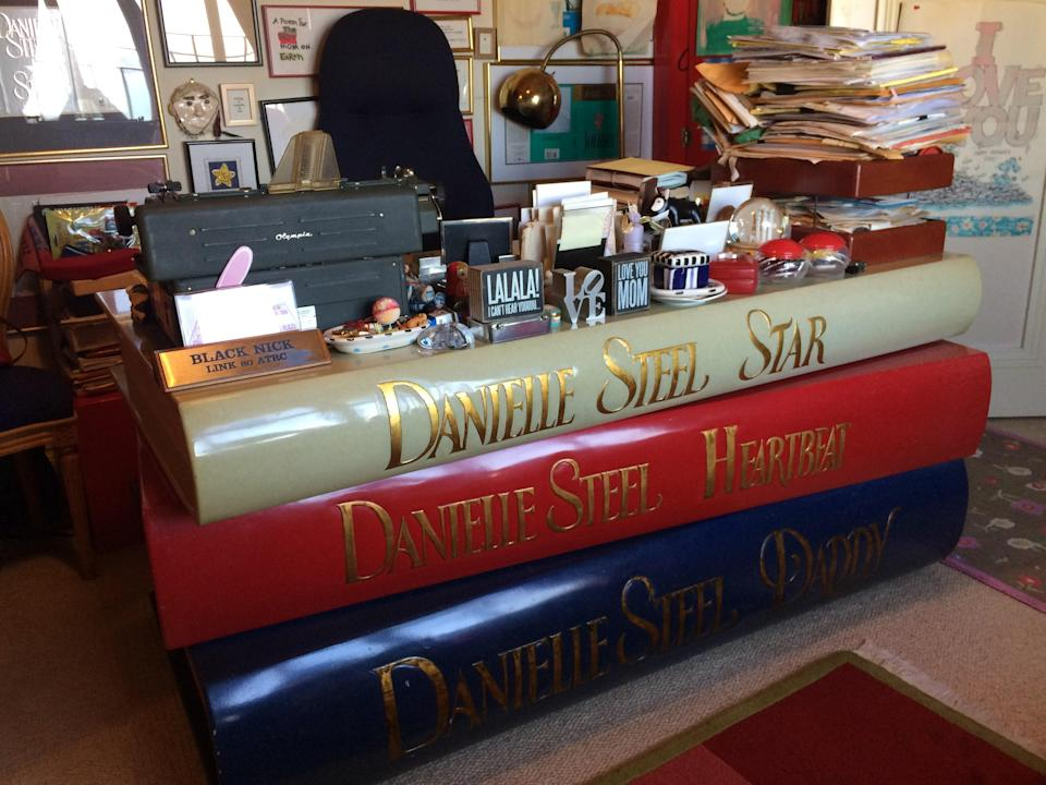 Danielle Steel's handcrafted desk in her San Francisco office, designed in the image of three of her best-selling books