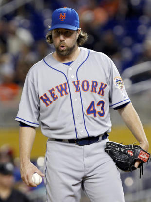 R.A. Dickey holds all the cards now. (AP)