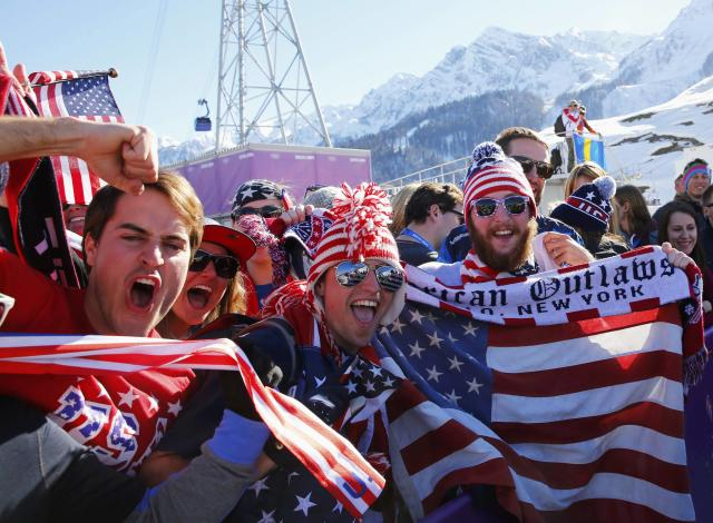 U.S. fans cheer during the men's freestyle skiing slopestyle finals at the 2014 Sochi Winter Olympic Games in Rosa Khutor February 13, 2014. REUTERS/Lucas Jackson (RUSSIA - Tags: SPORT SKIING OLYMPICS)