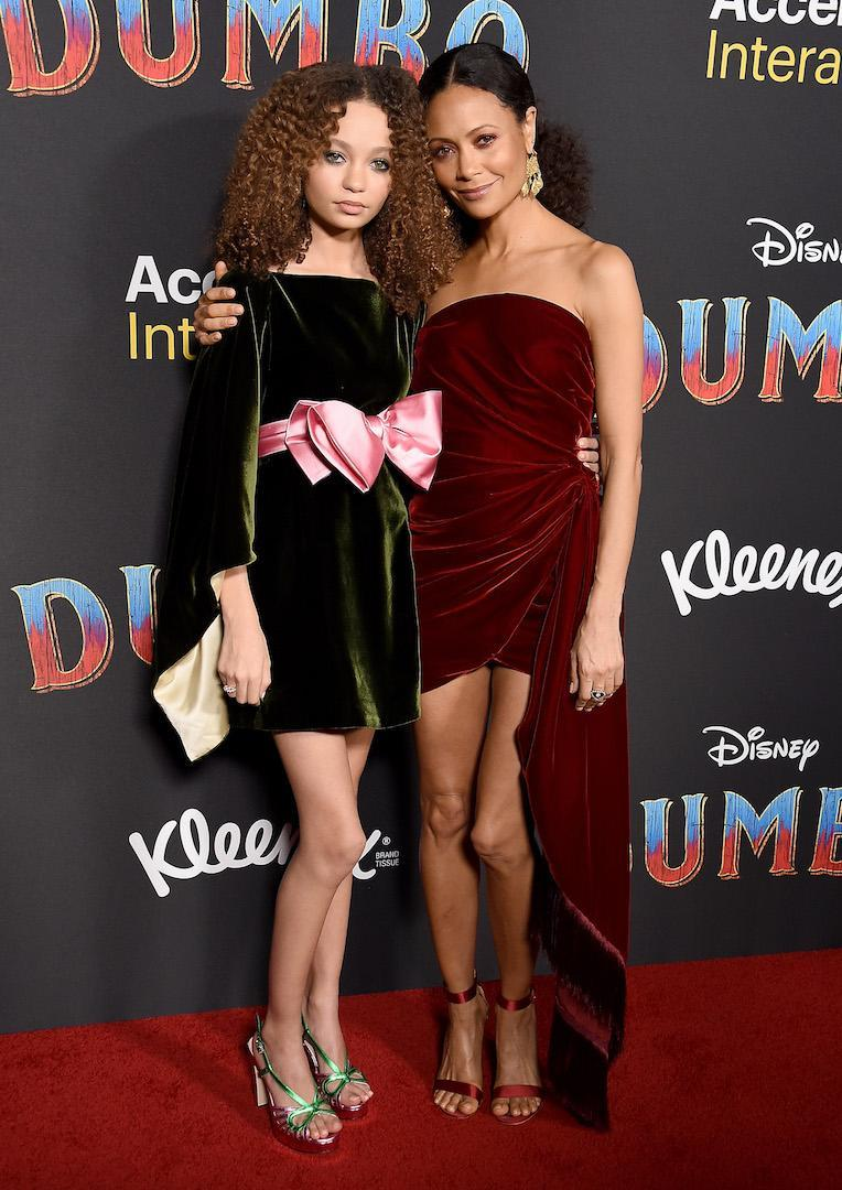 <p>Name a chicer mother-daughter duo. Thandie Newton and 14-year-old, Nico Parker, wore matching velvet ensembles at the red carpet event. Thandie opted for a crimson Oscar de la Renta dress while her daughter demonstrated her fashion know-how in a Gucci number. <em>[Photo: Getty]</em> </p>