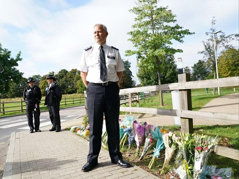 Chief Superintendent Trevor Lawry beside floral tributes to  Sabina Nessa (PA)