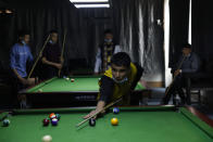Young Uyghur men play billiards in Poksam county in northwestern China's Xinjiang Uyghur Autonomous Region on March 21, 2021. Four years after Beijing's brutal crackdown on largely Muslim minorities native to Xinjiang, Chinese authorities are dialing back the region's high-tech police state and stepping up tourism. But even as a sense of normality returns, fear remains, hidden but pervasive. (AP Photo/Ng Han Guan)