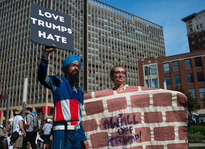 Anti-Trump activists protest on the first day of the Republican National Convention in Cleveland, Ohio, on July 18, 2016 (AFP Photo/Andrew Caballero-Reynolds)