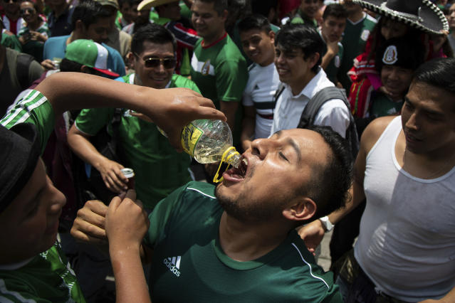 Party time: Mexico fans savour victory after their surprise Group F win. (PA)