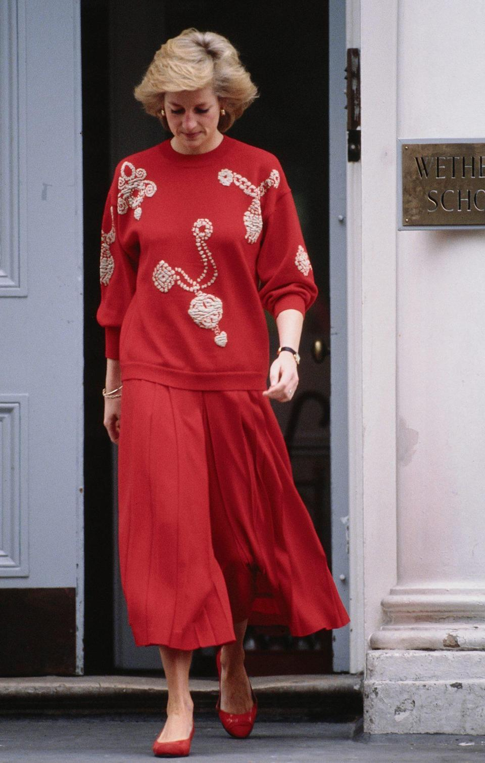 <p>For Prince Harry's first day of school, she wore a red skirt and coordinating knit.</p>