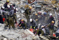 Crews from the United States and Israel work in the rubble Champlain Towers South condo, Tuesday, June 29, 2021, in Surfside, Fla. (AP Photo/Lynne Sladky)