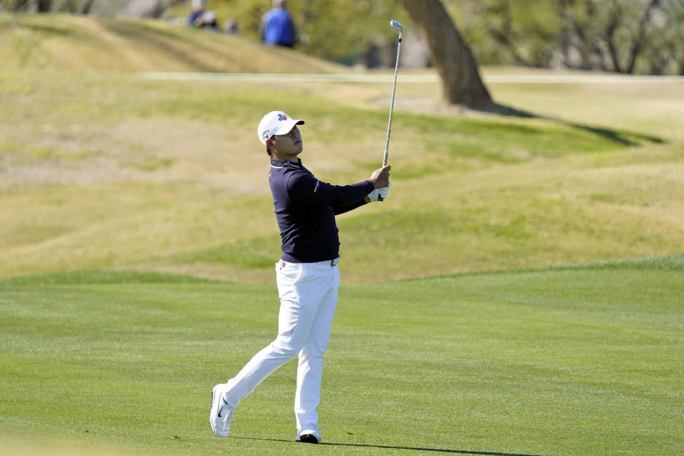 Si Woo Kim hits from the first fairway during the final round of The American Express golf tournament on the Pete Dye Stadium Course at PGA West Sunday, Jan. 24, 2021, in La Quinta, Calif. (AP Photo/Marcio Jose Sanchez)