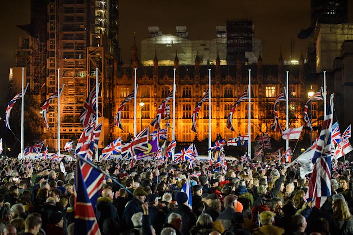 Pro-Brexit supporters gather in Parliament Square, London, as the UK prepared to leave the European Union at 11pm UK time. Picture date: Friday January 31, 2020. Photo credit should read: Matt Crossick/Empics